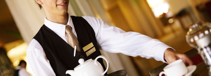 Young Waiter serving Tea